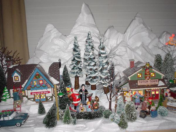 is a small display fit onto a window seat using Dept. 56 Snow Village ...